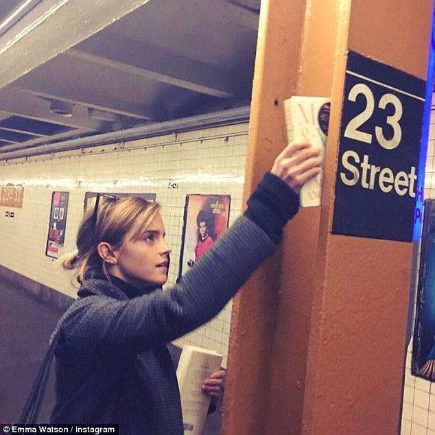 Emma Watson hiding book in the subway Book Ninja Bookclub