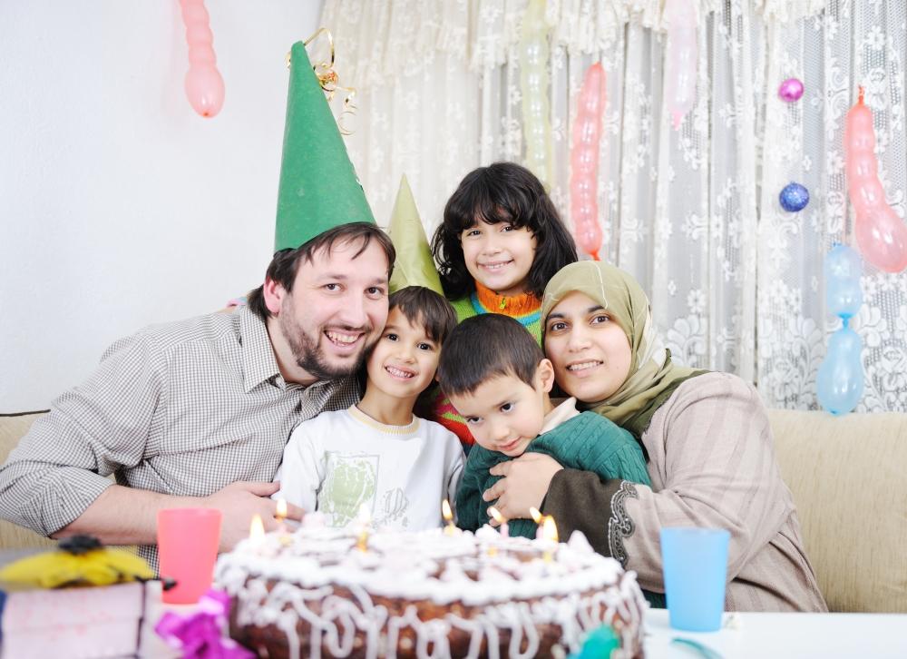 Birthday, happy Muslim family