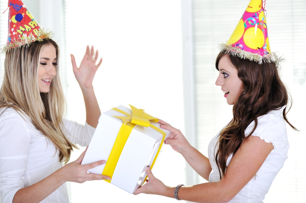 Bautiful caucasian girls wearing holiday hats